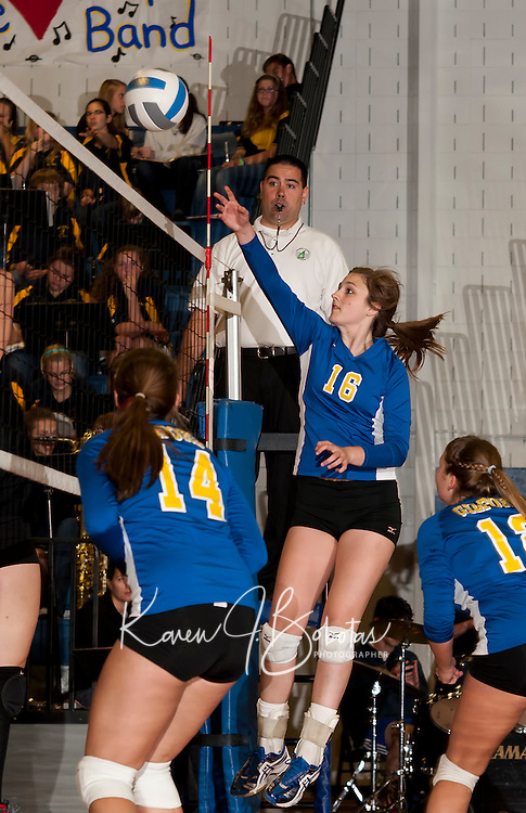 Gilford's Jessa Crites goes up for the ball during NHIAA Division II Volleyball action with Kennett Wednesday evening.  (Karen Bobotas/for the Laconia Daily Sun)