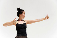 Woman with thumbs up kundalini yoga mudra.