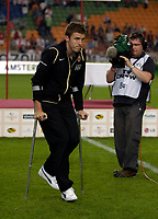 Photo: Daniel Hambury.<br />Ajax v Manchester United. Amsterdam Tournament. <br />05/08/2006.<br />Manchester's Michael Carrick on crutches at the end of the game.