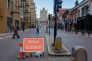 A Road Closed sign on the southern end of Londons the closed Tower Bridge, on 6th October 2016, in London, England. Closed for repairs to traffic and disrupting this major Thames crossing and surrounding roads for the next three months.