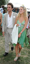 THOMAS VAN STRAUBENZEE and LADY MELISSA PERCY   at the Cartier International Polo at Guards Polo Club, Windsor Great Park on 27th July 2008.<br />