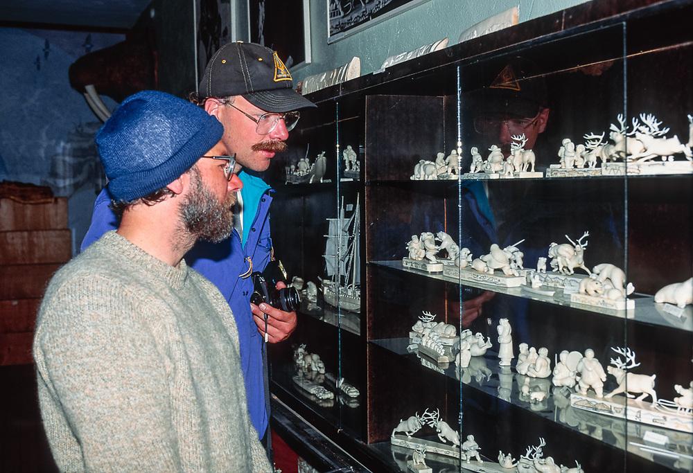 Dave Wukasch and Norm view ivory art on display, Uelen Art Studio, Village of Uelen, Chukotsk Peninsula, Northeast Russia