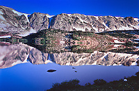 Reflections of the Snowy Range in Libby Lake.  Wyoming, USA.