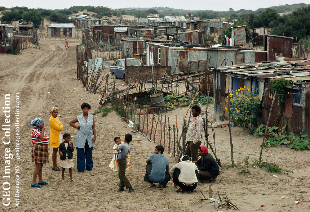 Racially mixed South Africans are forced into the slums.