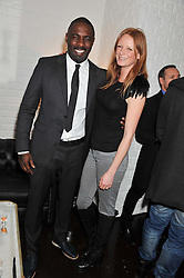 IDRIS ELBA and OLIVIA INGE at the opening of the 'pop up' Tanqueray Gin Palace hosted by Idris Elba at 13 Floral Street, Covent Garden, London on 26th March 2013.