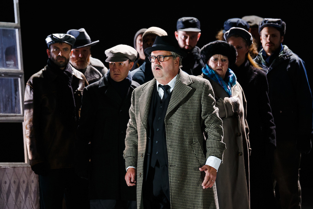 """LONDON, UK, 21 June, 2016. Graeme Danby (foreground, as Mayor) rehearses with members of the cast for the revival of director David Alden's production of Janacek's opera """"Jenufa"""" at the London Coliseum for the English National Opera. The production opens on 23 June. Photo credit: Scott Rylander."""