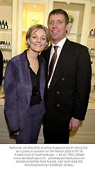 Perfumer JO MALONE and her husband GARY WILLCOX, at a party in London on 7th March 2002.OYD 18