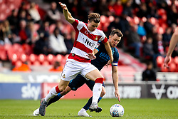 Ollie Clarke of Bristol Rovers challenges Ben Sheaf of Doncaster Rovers - Mandatory by-line: Robbie Stephenson/JMP - 19/10/2019 - FOOTBALL - The Keepmoat Stadium - Doncaster, England - Doncaster Rovers v Bristol Rovers - Sky Bet League One