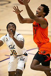 Feb 25, 2021; Berkeley, California, USA; Oregon State Beavers guard Gianni Hunt (0) drives to the basket ahead of California Golden Bears guard Makale Foreman (10) during the second half of an NCAA college basketball game at Haas Pavilion. Mandatory Credit: D. Ross Cameron-USA TODAY Sports