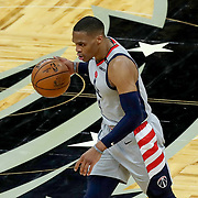 ORLANDO, FL - APRIL 07: Russell Westbrook #4 of the Washington Wizards dribbles the ball against the Orlando Magic at Amway Center on April 7, 2021 in Orlando, Florida. NOTE TO USER: User expressly acknowledges and agrees that, by downloading and or using this photograph, User is consenting to the terms and conditions of the Getty Images License Agreement. (Photo by Alex Menendez/Getty Images)*** Local Caption *** Russell Westbrook