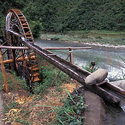 China, Agriculture, Water wheel brings water from river to rice fields.