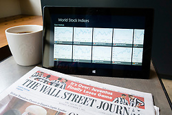 detail of financial newspaper and stock market performance shown on a Microsoft Surface rt tablet computer