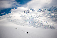 Mountain climbers make their way up Mt. Denali in Denali National Park in Alaska. Climbing Denali is an expedition, meaning that the mountain is almost always a multi-week endeavor, which is very different than an overnight or even multi-day climb.