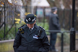 © Licensed to London News Pictures.12/12/2020. London, UK. Police guard a scene in Newham, south London after a 15-year-old schoolboy was fatally stabbed. Police were called at approximately 6:50pm to reports of male stabbed in Woodman Street last night. Photo credit: Marcin Nowak/LNP