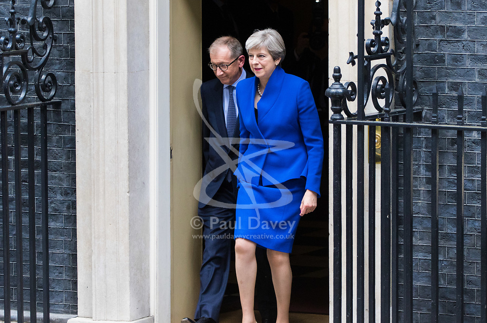 London, June 9th 2017. British Prime Minister Theresa May leaves Downing Street with her husband Philip on her way to Buckingham Palace to seek Her Majesty The Queen's permission to form a government following the general election where her Conservative Party lost is majority in the House of Commons.