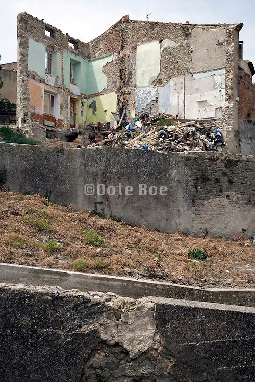 walls of a collapsed house