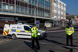 © Licensed to London News Pictures. 27/02/2019. London, UK. Police officers man the cordon outside Ilford Station, where a 20-year-old man was fatally stabbed last night. A murder investigation has been launched. Photo credit: Rob Pinney/LNP