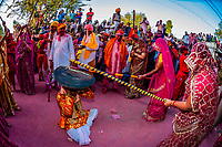 Indian women beat men with sticks (Lathi) during celebrations for Lathmar Holi in Barsana, Uttar Pradesh. Lathmar Holi is a local celebration of the Hindu festival of Holi (festival of color) - it translates as 'that Holi in which people hit with sticks'.