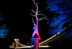 © Licensed to London News Pictures. 03/08/2015. Bristol, UK.  Bristol's skyline is lit up as two million volts of lightning are unleashed in front of the iconic Clifton Suspension Bridge, marking one month to go until Arcadia hosts the world's first recycled biofuel pyrotechnics show to mark the city's status as European Green Capital 2015.  The one-off event, which will present Arcadia's new show 'Metamorphosis', will see its famous mechanical spider - built in the West country from 50 tonnes of recycled military hardware - convert its signature flames to use 100 per cent recycled biofuel for the first time. Arcadia presented the 'Lord of Lightening' Frequency Rider (played by Joshua Leighton-Trew), who unleashed two million volts in front of the iconic Clifton Suspension Bridge, powered by a generator using the same recycled fuel. Photo credit : Simon Chapman/LNP