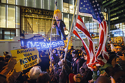 November 9, 2016 - New York, US, UK - New York, USA. Thousands of anti-Trump demonstrators protest outside Trump Tower with a Donald Trump pinata after marching from Union Square in New York City, on Wednesday, 9 November 2016 following the presidential election won by Donald Trump. (Credit Image: © Tolga Akmen/London News Pictures via ZUMA Wire)