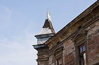 Old building with spire and ornate windows in Krakow Poland