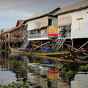 Wooden fishing village huts on stilts above water (Siem Reap, Cambodia - Oct. 2008) (Image ID: 081023-1702281a)