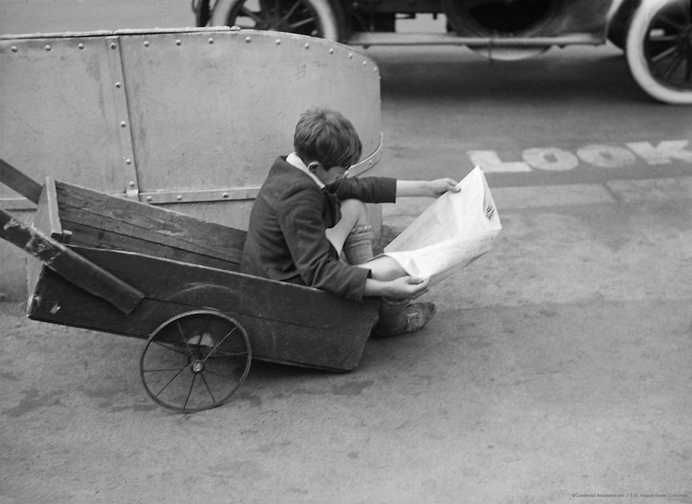 Urchin (Boy) Reading Newspaper, London, England, 1933