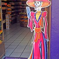 Americas, Mexico, Guanajuato. La Catrina, a skeletal woman symoblizing death, greets visitors to the sweet shop of the same name in Guanajuato.