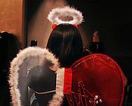 Nida Gilani, dressed as a dark angel, waits in a bathroom line on Halloween at Lavish nightclub in downtown Denver.