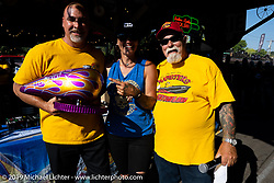 Dave and Jody give out the best paint award at their Perewitz Paint Show at the Iron Horse Saloon during the Sturgis Motorcycle Rally. Sturgis, SD, USA. Wednesday, August 11, 2021. Photography ©2021 Michael Lichter.