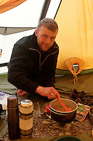 Man doing the coocking in a lavvo