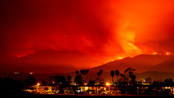 Jul 8, 2017 - Goleta, California, U.S. - Whittier wildfire flames light up the night sky over apartments in Goleta. The Whittier Fire has now scorched 10,823 acres and is 5% contained. There is over 700 personnel currently involved in this firefight. 3,500 people have been evacuated mostly from the Lake Cachuma and Camp Whittier area. (Credit Image: © Michael Nekrasov via ZUMA Wire)