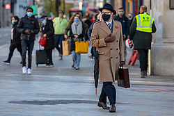 © Licensed to London News Pictures. 04/11/2020. London, UK.A smartly-dressed man wears a face mask on Oxford Street on the final day before non-essential show will close for a second lockdown. The government has announced a new national lockdown for England starting on Thursday 5th November and lasting for a month. Photo credit: Rob Pinney/LNP
