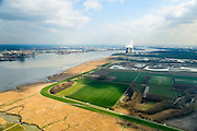 Nederland, Zeeland, Zeeuws-Vlaanderen, 01-04-2016; Hertoging Hedwige polder gezien naar de Belgische Prosperpolder, reeds ontpolderd. Westerschelde links, kerncentrale Doel aan de horizon. In verband met de verdieping van de vaargeul van de Westerschelde moet er volgens de Europese habitatrichtlijn natuurcompensatie komen. Door de polders te ontpolderen wordt er grond terug gegeven aan de natuur, zogenaamde natuurcompensatie. <br /> Hertogin Hedwige polder has to be de-poldered, because of the enlargement of the fairway of the nearby Scheldt, the nature has to be compensated (according to the European Habitats Directive), the measures are controversial. The Belgian Prosperpolder on the horizon and right next to the port of Antwerp is already 'de-polderd' .<br /> luchtfoto (toeslag op standard tarieven);<br /> aerial photo (additional fee required);<br /> copyright foto/photo Siebe Swart