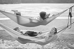 March 27, 2019 - Eagan, MN, USA - JUST HANGING OUT ON SPRING BREAK -..As temps climbed into the mid 60's on Wednesday, Erica Stockdale (bottom left) Emily Gadker (bottom right) and  Arin Kujala (top) decided to hang out along the frozen shores of Schultze Lake in Lebanon Hills Regional Park in Eagan.  The girls are 10th graders Spring Break from Rosemount High School... ]..brian.peterson@startribune.com..Minneapolis,  MN ..Wednesday, March 27, 2019 (Credit Image: © Brian Peterson/Minneapolis Star Tribune via ZUMA Wire)