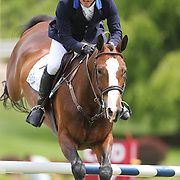Alvaro Tejado riding Voltaral Palo Blanco in action during the $35,000 Grand Prix of North Salem presented by Karina Brez Jewelry during the Old Salem Farm Spring Horse Show, North Salem, New York, USA. 15th May 2015. Photo Tim Clayton