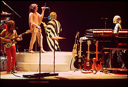 """Yes Performing Live in Concert """"In The Round"""" at the New Haven Coliseum Connecticut on 4 September 1978. Band Members this Tour: Jon Anderson, Steve Howe, Chris Squire, Alan White & Rick Wakeman. The song is Awaken it's the only time Steve used a Rickenbacker 12-string."""