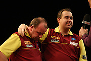 Darts: Betfair Team World Cup 2013, Hamburg, 03.02.2013<br /> Kim Huybrechts and brother Ronny Huybrecht (BEL) sorrows, as they addict their winning semi final to his dead father<br /> © Torsten Helmke