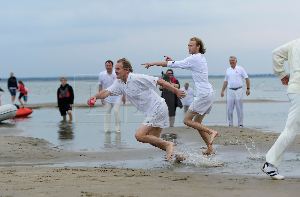 © Licensed to London News Pictures. 18/09/2016. Portsmouth, UK. A fielder attempts to a run out. Teams take part in the  Bramble Bank Cricket Match in the middle of The Solent strait on September 18, 2016. The annual cricket match between the Royal Southern Yacht Club and The Island Sailing Club, takes place on a sandbank which appears for 30 minutes at lowest tide. The game lasts until the tide returns. Photo credit: Ben Cawthra/LNP