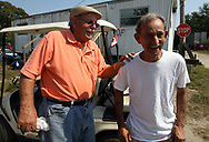 Pop shares a laugh with Coy Honeycutt at Coy and Karen's Auto Parts junkyard in Myrtle Beach, S.C. Honeycutt is giving Smith a job, food, clothes, and a place to stay under the condition that he stay sober and attend church.