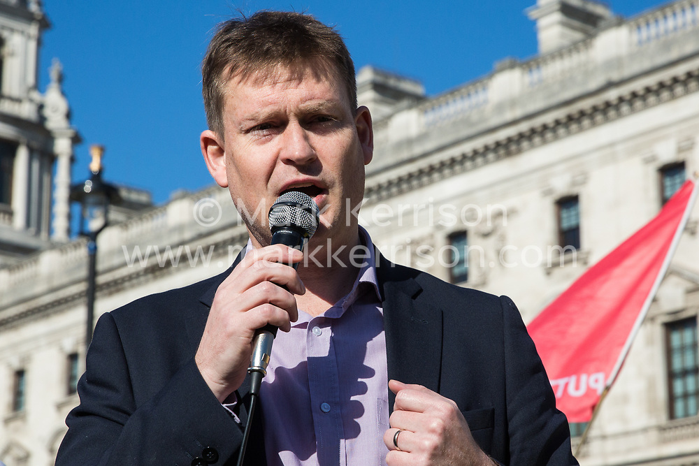 London, UK. 26th February, 2019. Justin Madders, Labour MP for Ellesmere Port and Neston, addresses mainly migrant striking outsourced workers belonging to the Independent Workers of Great Britain (IWGB), United Voices of the World (UVW) and Public and Commercial Services Union (PCS) trade unions working at the University of London (IWGB), Ministry of Justice (UVW) and Department for Business Energy and Industrial Strategy (PCS), together with representatives of the National Union of Rail, Maritime and Transport Workers (RMT) Regional Council, taking part in a 'Clean Up Outsourcing' demonstration to call for an end to the practice of outsourcing. The demonstration was organised to coincide with a significant High Court hearing of an application by the IWGB for judicial review of a decision by the Central Arbitration Committee (CAC) not to hear their application for trade union recognition for the purposes of collective bargaining with the University of London.