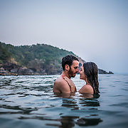 A couple enjoy an intimate moment in the quiet water by Honeymoon beach, a small, secluded beach about 15 minutes boat ride south of Agonda beach.