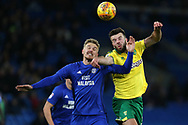 Danny Ward of Cardiff city (l) challenges Grant Hanley of Norwich city ®. EFL Skybet championship match, Cardiff city v Norwich city at the Cardiff city stadium in Cardiff, South Wales on Friday 1st December 2017.<br /> pic by Andrew Orchard, Andrew Orchard sports photography.