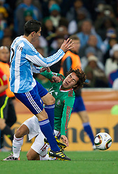 Angel Di Maria of Argentina vs Efrain Juarez of Mexico during the 2010 FIFA World Cup South Africa Round of Sixteen match between Argentina and Mexico at Soccer City Stadium on June 27, 2010 in Johannesburg, South Africa. Argentina defeated Mexico 3-1 and qualified for quarterfinals. (Photo by Vid Ponikvar / Sportida)