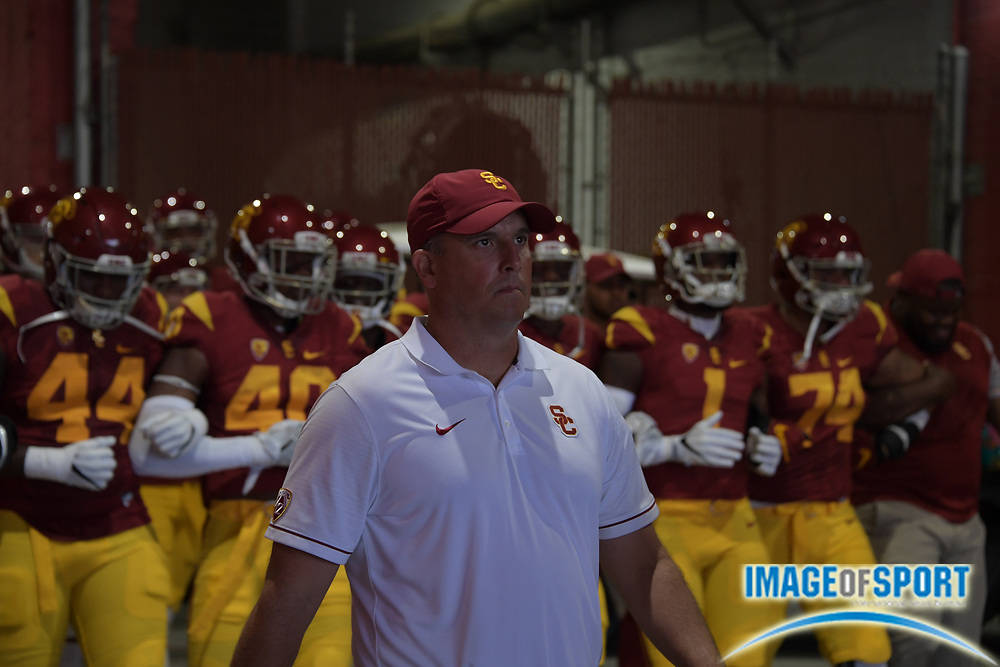 Sep 10, 2016; Los Angeles, CA, USA; USC Trojans head coach Clay Helton leads players onto the field during a NCAA football game against the Utah State Aggies at Los Angeles Memorial Coliseum.