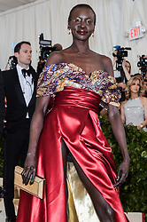 Alek Wek walking the red carpet at The Metropolitan Museum of Art Costume Institute Benefit celebrating the opening of Heavenly Bodies : Fashion and the Catholic Imagination held at The Metropolitan Museum of Art  in New York, NY, on May 7, 2018. (Photo by Anthony Behar/Sipa USA)