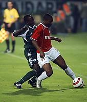 Fotball<br /> Foto: Wrofoto/Digitalsport<br /> NORWAY ONLY<br /> <br /> UEFA Champions League third qualifying round soccer match in Krakow, Poland, on Tuesday, Aug. 9, 2005<br /> WISLA KRAKOW v PANATHINAIKOS ATHENS<br /> KRAKOW 09/08/2005<br /> <br /> EMANUEL OLISADEBE / PANATHINAIKOS/ KALU UCHE / WISLA