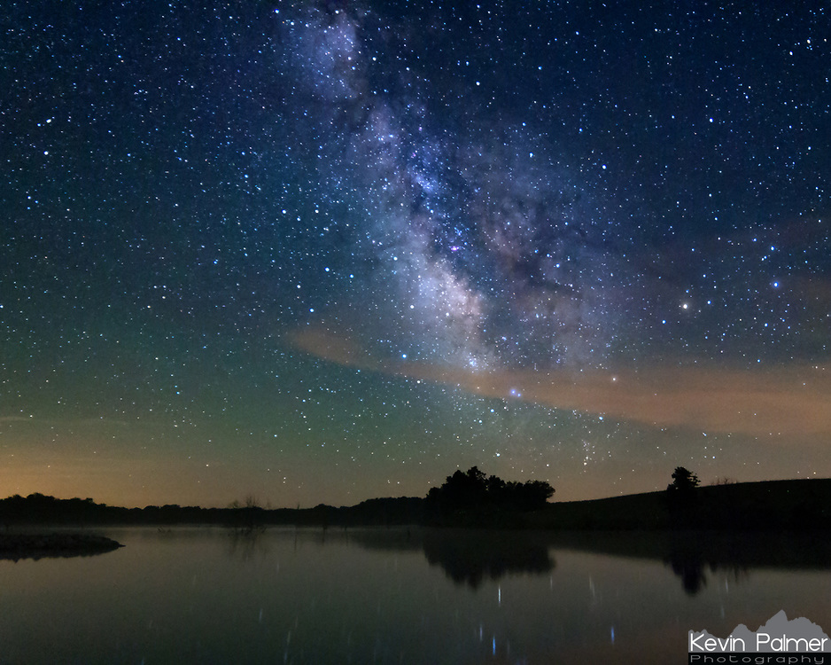 In June of 2013 I drove into southeast Iowa looking for the darkest sky I could find. The stars were breathtaking around Lake Sugema, Iowa. I could see more detail in the milky way than I had ever seen before. To the left is green airglow, which is a weak emission of light by the earth's atmosphere. On this night I also saw about 15 meteors.