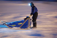 Dog Sledding Outside Tromsø. Image taken with a Nikon D2xs and 50 mm f/1.4 lens (ISO 800, 50 mm, f/1.4, 1/6 sec)..