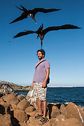 Model With Great Frigate Bird (Fregata minor ridgywayi)<br /> KT 015 Emil Klein<br /> North Seymour<br /> Galapagos<br /> Ecuador, South America
